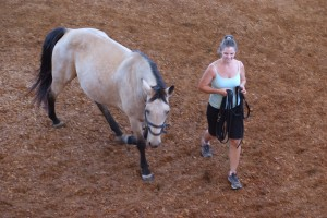 Diane leading a horse in the roundpen